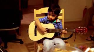 "Bambino Playing Guitar ""kuno"""