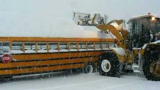 Cat loader getting snow off a school bus, Kitimat syle(I had to get the bus ready for Monday morning. How to get that snow off the roof so it didn't slide off and hurt someone., 2009-01-04T22:25:47.000Z)