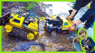Tow Trucks and Construction Trucks in the MUD!