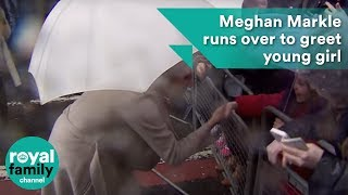Meghan Markle runs over to greet young girl in Belfast