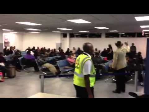 Haitian man goes nuts in Airport!!