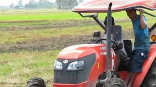 M6040 Kubota tractor on vietnamese farmer field