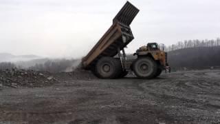 789 Caterpillar Hauler Dumping a Load of Rock