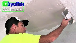 In this Part 4 Mudding and Skim Coating a drywall ceiling repair ti...
