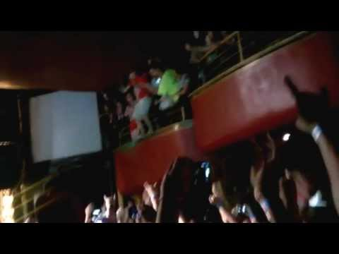 Kid dose awesome jump at a Green Day show.
