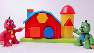 GREEN BABY in LEARNING SHAPES WITH HOUSE TOY