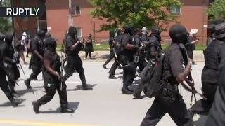 Armed members of NFAC all-black militia march in Louisville to demand justice for Breonna Taylor