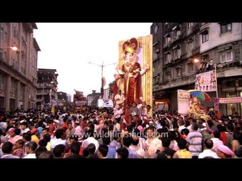 Huge detailed Ganpati carrried as crowd...