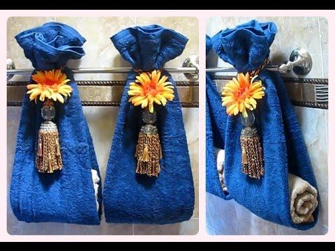 Como decorar las toallas de ba o para que luzcan difentes for Colgador de toalla para bano