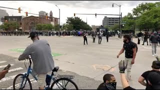 "Protestors walking into Detroit riot police at end of ""By All Means Necessary"" march"