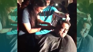 Katrina Kaif gives a Hair Cut To Anurag Basu
