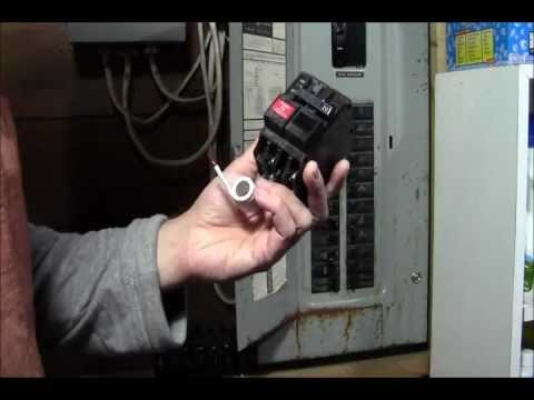 RicksDIY Replacing GFCI 2Pole Breaker On A HotLive Panelwmv YouTube