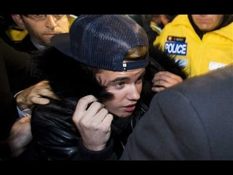 JUSTIN BIEBER arrested again in 2014: Bieber turns himself in at Toronto for assaulting limo driver.