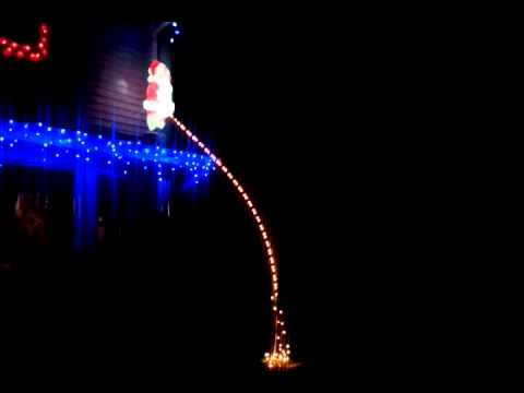 Santa pissing off roof