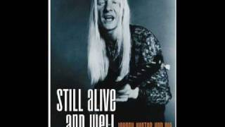 Watch Johnny Winter Murdering Blues video