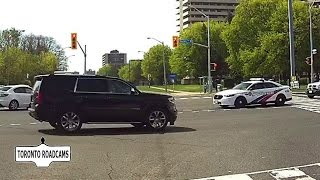 SUV runs light in front waiting Toronto Police car
