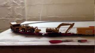 HO Scale Train Hauling CAT Heavy Equipment