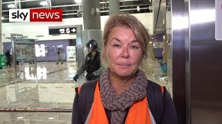Sky journalist confronts Hong Kong riot police officer