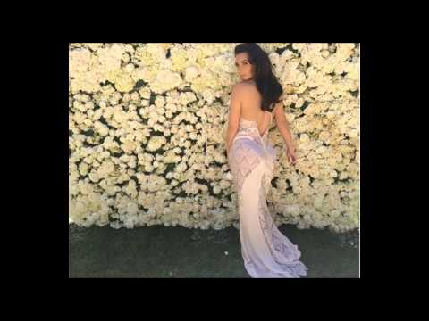 Kim Kardashian Lacy Gown Against A Wall Of Roses 5 14