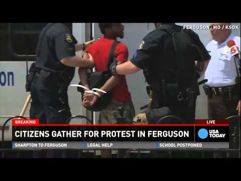 Michael Brown protesters arrested, taken away by police