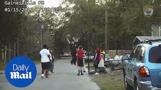 Florida cop plays basketball with kids after noise complaint - Daily Mail