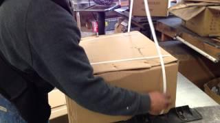 Using plastic strap on box