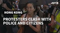 Hong Kong police make arrests as 'flashmob' protests hit pro-Beijing targets | AFP