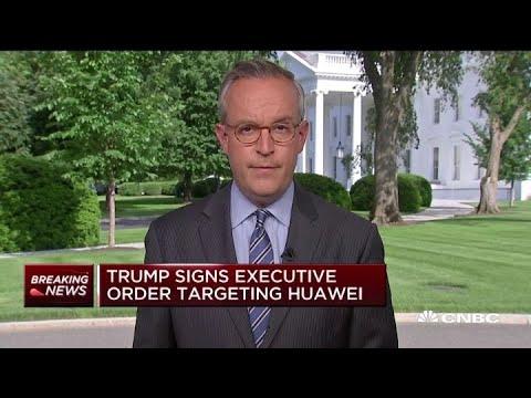 Trump signs executive order targeting Huawei