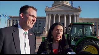 Governor drives tractor to work
