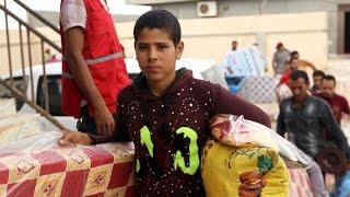 أخبار عربية | الهلال الأحمر الليبي يوزع مساعدات إنسانية في سرت