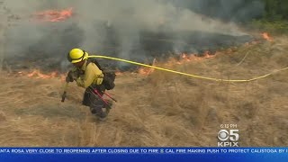 FIREFIGHTERS: Firefighters from across the West and California help save wineries