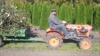 Traktorek ogrodowy Kubota 6001 z przyczepką. www.akant-ogrody.pl