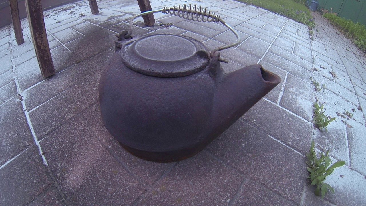 soda blasting a cast iron kettle