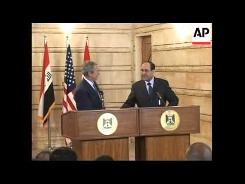 President Bush ducks as man throws shoes during news conference