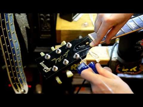 Restring a Guitar by Bill Baker filmed in HD closeup demo on MISFITS guitar Pt. 1