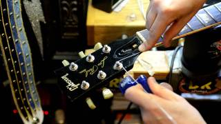 Restring a Guitar by Bill Baker filmed in HD closeup demo on MISFITS guitar Pt. 1