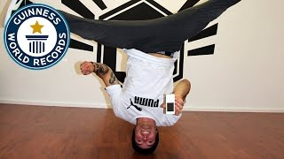 Fastest time to type a SMS while performing head spins - Guinness World Records