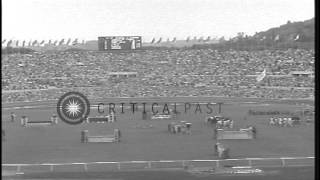 Closing event of Summer Olympics of 1960 showing Equestrian finals along the stad...HD Stock Footage