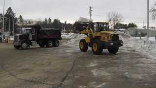 Loading Dump Truck With Snow