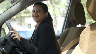 Side view of a young businesswoman in her car ready to drive to her workplace for a meeting