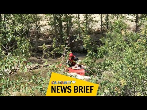 Couple rescued from raging creek