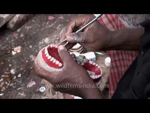 Roadside dentist shows how he makes false teeth