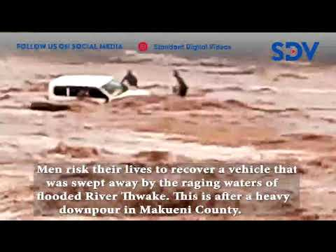 Men risk their lives to recover a vehicle that was swept away by raging waters of River Thwake