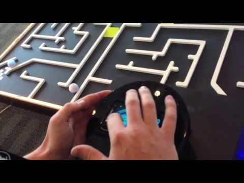 Smartphones Race Robotic Balls Through Golf Maze