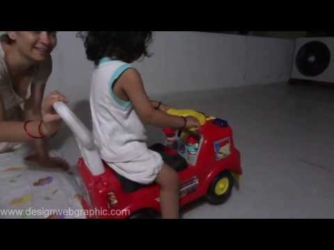 Small Kid Playing Fisher Price Fire Truck Ride On Kavil in Summer Ahmedabad Gujarat India