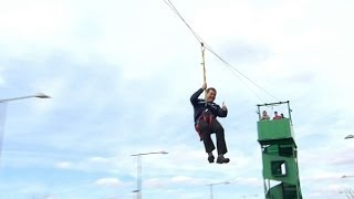 Broadcaster Murphy tests out the zip line