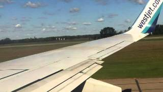 WestJet, taxi and take off from Edmonton International Airport...