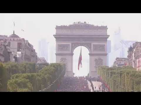 A vast crowd gathered in central Paris on Monday to welcome back France's victorious World Cup soccer team. (The Associated Press)