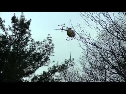 Aerial Saw. Aerial Solutions in Action. Helicopter Tree Trimming. Hughes 500D.