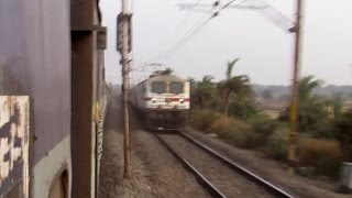 High speed xing! 22823 BBS-NDLS Rajdhani Express xings with 12767 NED-SRC Express